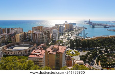 Panorama on the port of Malaga, Andalusia, Spain, with the famous bullring La Malagueta on the left. - stock photo