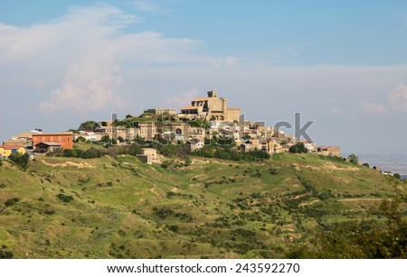 Panorama on the town and 12th Century fortified church of Santa Maria in Ujue, (Uxue in Basque), a town in Navarre, Northern Spain. - stock photo