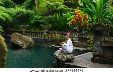 Panorama pf young woman doing yoga outdoors in tranquil environment - stock photo