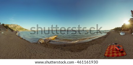 Panorama photo of a beautiful beach just right before sunset.