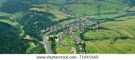 panorama photo of Dunajec river dividing Poland and Slovak republik. Red Cloister (slovak: Cerveny klastor) in picture. Photo taken from Three Crowns hills. - stock photo