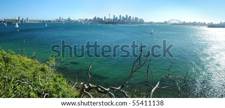 panorama photo of Sydney scenery, CBD, Sydney Tower and Harbor bridge visible - stock photo
