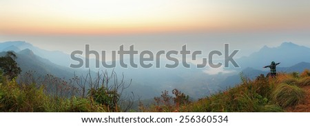 Panorama photos of the scenery and natural beauty in a morning,The ladies enjoying in picture at PHU CHEEFA PARK , Chiangrai in Thailand - stock photo
