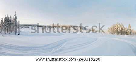 Panorama picture of a winter landscape at lapland - stock photo