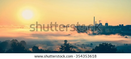 panorama, power station and sunrise with the mist filter - stock photo
