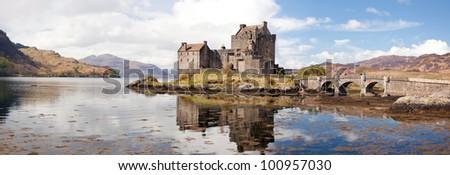 Panorama Reflection of Eilean Donan Castle, Highland Scotland. - stock photo