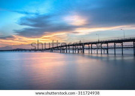 Panorama scene of  transportation cargo bridge to seaport along twilight sky at beautiful - stock photo