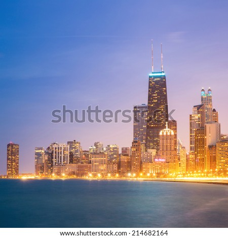 Panorama shot of Chicago downtown and Lake Michigan at dusk. - stock photo