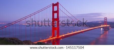 Panorama Shot of Golden Gate Bridge at sunset time - stock photo