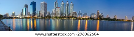Panorama tower night landscape with water reflection. - stock photo