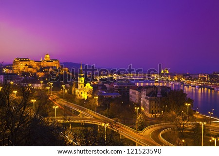 Panorama view at night from the Gellert hill to the Buda castle, the Parliament and the Chain Bridge in Budapest, Hungary - stock photo