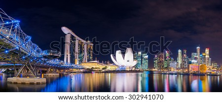 Panorama view at night of Marina Bay and Singapore skyline - stock photo