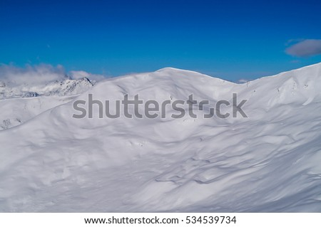 Panorama view from the summit of a mountain in the alps of Austria in the winter with snow (Nauders, Tirol)