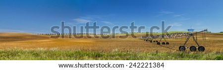 Panorama view of a industrial irrigation equipment on a field. - stock photo