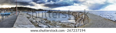 Panorama view of a pier and the ocean at dusk/panorama ocean and pier/sweden - stock photo