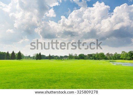 Panorama view of beautiful summer park with cloudy sky - stock photo
