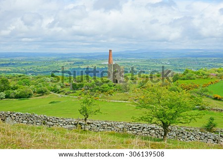 Panorama view of Bodmin Moor, the ruins of a Cornish Tin Mine, the Phoenix United Mines Prince of Wales Engine House can be seen in the distance, at Minions on Bodmin Moor in Cornwall, United Kingdom