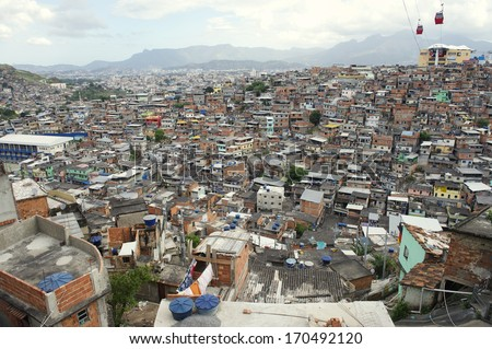 Panorama view of Brazilian urban slum favela Complexo Alemao in Rio de Janeiro featuring cable car transportation - stock photo