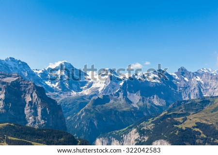 Panorama view of Breithorn and the Alps on Bernese Oberland and the Lauterbrunnen valley from Mannlichen station, Switzerland.