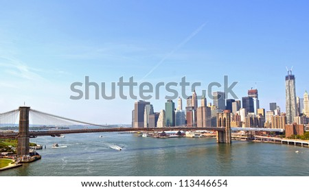 Panorama view of Brooklyn Bridge and Downtown Manhattan in the background - stock photo