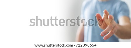 Panorama view of businessman pointing finger on blurred background