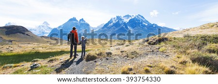 panorama view of family enjoying active vacation in patagonia and hiking in torres del paine national park, chile - stock photo