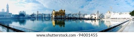 Panorama view of golden emple, the main sanctuary of Sikhs, Amritsar, India - stock photo