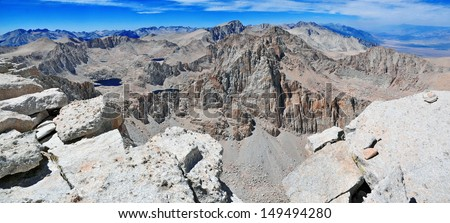 Panorama View of Mount Whitney from the Summit of Mount Langley, with smoke from forest fire in background, Sierra Nevada Mountains, California - stock photo