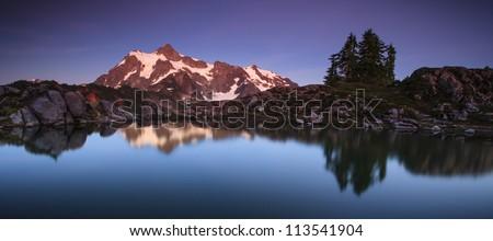 Panorama view of mountain and lake - stock photo