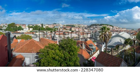 Panorama view of old town Lisbon and Sao Jorge Castle from Garden of San Pedro de Alcantara, the capital and the largest city of Portugal. - stock photo