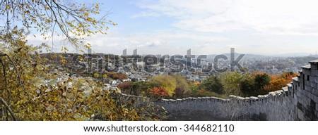 Panorama view of the fortress wall of Bugaksan mountain near Seoul, South korea.The wall stretches 18.6 km along the ridge of Seoul's four inner mountains, Baegaksan, Naksan, Namsan, and Inwangsan - stock photo