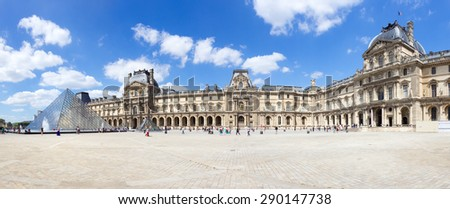 Panorama view of the inner court of the Louvre museum. The museum is one of the world's largest museums and the most popular tourist destinations in France. - stock photo