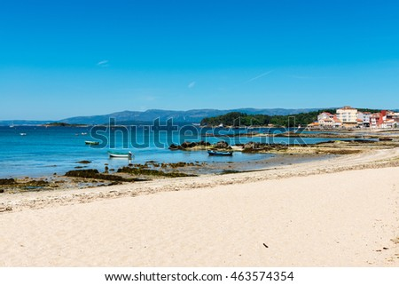 Panorama view of the main beach of Villagarcia de Arosa (Vilagarcia de Arousa) at the Rias Baixas in Galicia, Spain, with the fishermen village of Carril in the background.