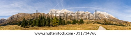 Panorama view of the Montasio Massif from the souther side (Pecol Alm) at a sunny autumn day. - stock photo