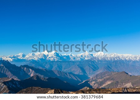 Panorama view of the mountain range including Minya Konka (7556m) from top of cattle back mountain in the morning, Sichuan Province, China - stock photo