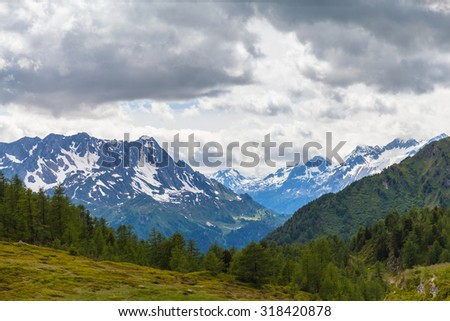 Panorama view of the mountain range of swiss Alps in Canton Tessin (Ticino),  beyond the Ritom lake, Switzerland.