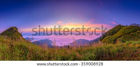 Panorama view of the sunrise at Doi Pha Tang, Chiang Rai, Thailand. - stock photo