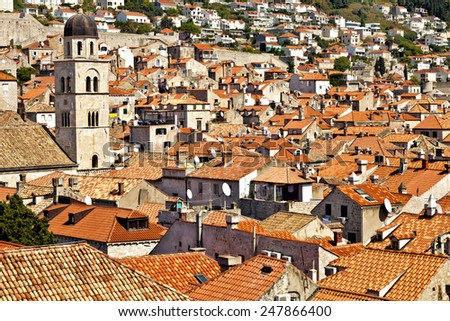 Panorama view over old, historic Dubrovnik town red tiled roofs - stock photo
