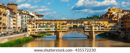 Panorama view to ancient bridge ponte vecchio at river arno in florence old town famous touristic place of tuscany region italy - stock photo