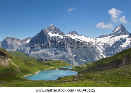 Panorama view towards the Bachsee and the Wetterhorn and the Schreckhorn in the Swiss Alps.