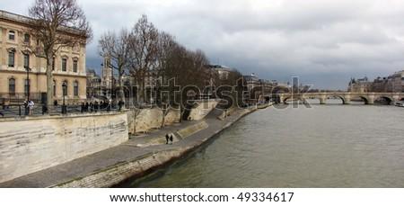panorama winter paris and  river seine - stock photo
