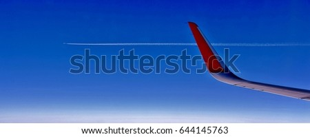Panorama with Airplane wing and blue sky