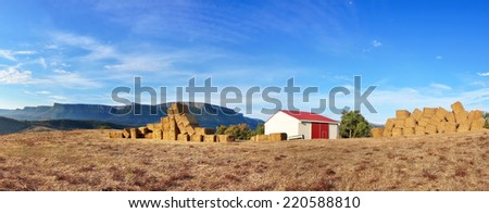 panorama with farm and bales - stock photo