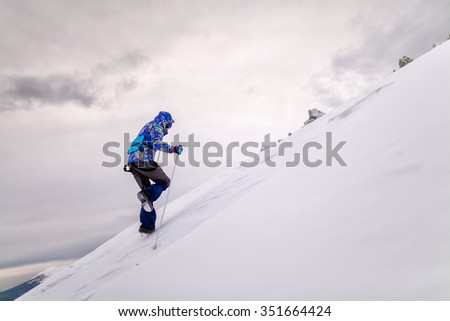 Panorama with hiker woman in a snowy mountains. South Ural