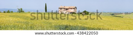 panorama with single farm in Tuscany in Italy - stock photo