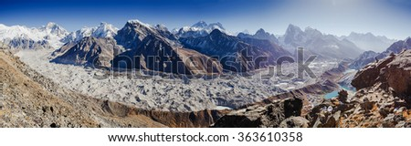 Panorama witn Himalaya mountains. Mount Everest (8,848 m) and the Glacier from the summit of Gokio Ri, Himalayas, Nepal. - stock photo