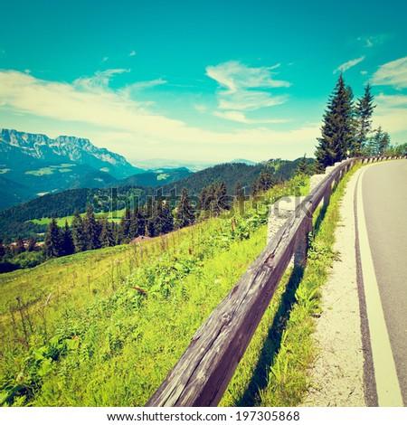 Panoramastrasse- Asphalt Road in the Bavarian Alps, Retro Effect - stock photo