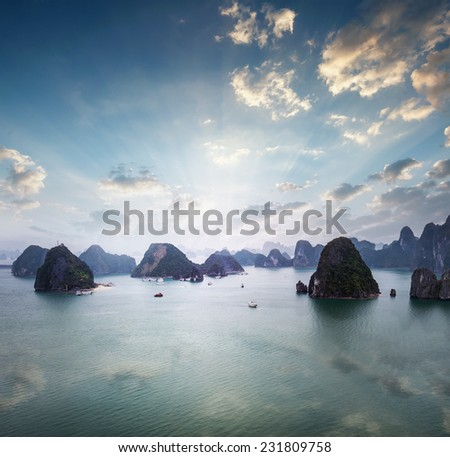 Panoramic aerial view of Halong Bay in Vietnam at early sunrise. Amazing nature landscape background - stock photo