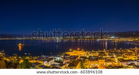 Panoramic aerial view of Nafplio city at night from the clock tower hill