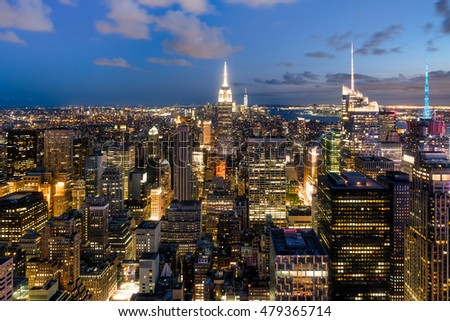 Panoramic aerial view of New York City at sunset with all the buildings and skyscrapers illuminated